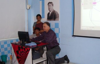 Teaching a class in a math lab designed by Steve and business partner NIIT in Chennai, India, 2007.