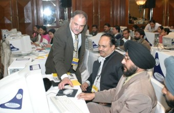 Conducting a hands-on workshop in New Delhi for 150 Indian school teachers in 2004.
